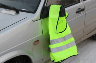 Что означает жилетка на зеркале стоячего автомобиля